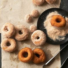 Spiced Pumpkin Doughnuts These delicious homemade doughnuts are rolled in a mixture of sugar, nutmeg, and cinnamon, complementing their pumpkin flavor.