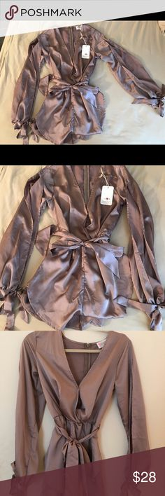 silk romper size small with tags -New with tags  -Size small women's silk romper  -color is a purplish pink, id say a darker champagne  -beautiful on, will fit a women's size 0-2 perfectly, size 4 if you are a bit shorter.  -never been worn  -front tie and tie's on the arms boutique Dresses