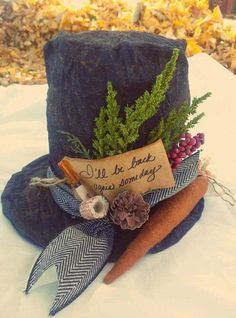 Our handmade snowman hat would look beautiful with your seasonal decor. It includes a corncob pipe, a carrot nose, and Ill be back again someday Primitive Christmas, Country Christmas, Christmas Snowman, Winter Christmas, Christmas Holidays, Christmas Decorations, Christmas Ornaments, Christmas Swags, Holiday Centerpieces