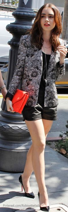 Lily Collins and her patterned jacket is just super sensational.  The red clutch just finishes things off nicely.  I'm seeing a lot of leather shorts recently - a look that requires youth, confidence (and slim legs!) to pull off.  For those lucky ones that can, keep the heels simple, and accessories sensational.  Just like this.