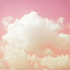 Pink sky with fluffy white clouds.