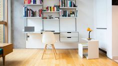 On its side, 621 provides an additional surface for a lamp in a home office. Seen here with its sibling the 606 Universal Shelving System