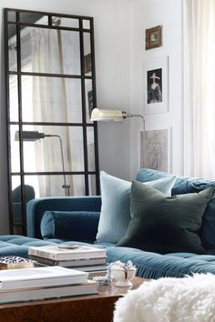 Really into this color story at the moment.  Blue, baby blue and dark green velvets for the sofa! Designer unknown