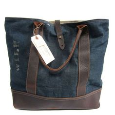 carryall handmade from leather and worn-in denim salvaged from a WWII era US Navy barracks bag