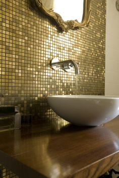gold bathroom with golden mosaic, antique frame mirror, gold mosaic Dune, mirror in bathroom