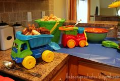 baby shower car truck themes | The serving dishes were a mixture of trucks and sand toys.