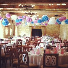 How about hanging pom poms from the beams in your colours?