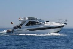 BAVARIA SPORT 35 HT - with Hard Top from 2013. powered by a stern drive Volvo Penta D6 EVC diesel engine with 370hp. Well equipped. Spacious cockpit with ample seating, wet bar, fridge, BBQ/grill and an electrical operated sunroof in the hardtop. Below deck a main saloon with settee, a well-equipped galley, a commodious owner's cabin, a guest cabin and a head with electrical toilet and shower. **This boat is no longer for sale**