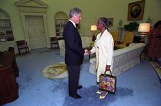 President Bill Clinton greets Shirley Chisholm, Ambassador-Designate to Jamaica, in the Oval Office of the White House. Clinton had nominated Chisholm to be U.S. Ambassador to Jamaica, but she could not serve due to illness.  Chisholm had been elected as the first African American congresswoman in 1968. A teacher by profession who turned to politics, she served in the New York State Assembly before her time in Congress.  National Archives Identifier: 2842929, Clinton Presidential Library