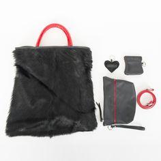 La Connie è una deliziosa borsa in pelliccia murmel russo. Con manici a mano in pelle lucida rossa. L'intera borsa, realizzata con tecniche artigianali. Senza fodera. Clicca qui per acquistarla: http://www.borsemami.it/shop/it/home/86-borsa-connie.html?search_query=connie&results=1  Dimensioni: 36x40 In omaggio con questa borsa, uno stupendo portachiavi.