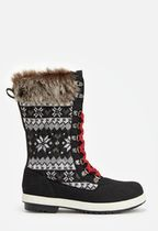 Give your cold weather style a textured appeal with these faux suede boots featuring a printed sweater detail and faux fur cuff. They're sure to make your look stand out in the best way!  ...