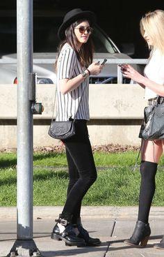 Kylie Jenner wearing Chanel Half Moon Bag J Brand 815 mid-rise velvet skinny jeans Balenciaga Buckle Strap Ankle Boot Linda Farrow x The Row Sunglasses Theory Twine Small Print Klima Blouse