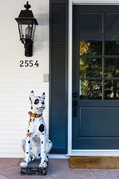 "Even before you step inside, a pair of ceramic dogs flanking the front door signal the fun-loving approach to decorating that awaits within. ""They add so much character, and I love how they're not so serious,"" says Lauren."