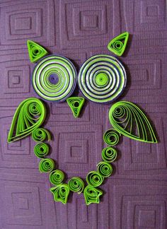 Wendy Verity of Australia made this adorable abstract owl... sorry the pic is a bit overexposed, but we can make out the clever design just fine. She rolled silver-edged paper with green and purple to give his eyes such a nice shine, and he looks very handsome against the Cuttlebug embossed background.
