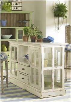 Unique kitchen island or console made from old widows. Now that's just fun.