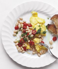 scrambled eggs with beans . tomatoes . pesto