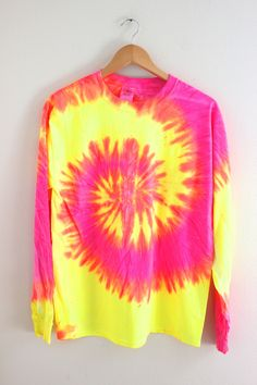 Neon pink, yellow and orange tie-dyed, 100% cotton, long sleeve unisex t-shirt. Please note: Each tie-dyed tee is hand dyed and slightly unique. Washing instructions: Machine wash inside out in very c