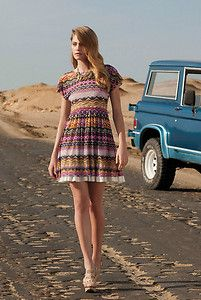 That car in the background should be a VOLVO; maybe then this damsel wouldn't be stranded. At least she's ready for rough terrain with those shoes.