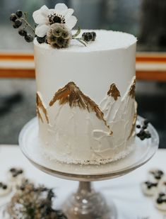 Winter Wedding Inspiration | Wedding Cake with Gold Mountain Top details | Photo by Julia Green Photography