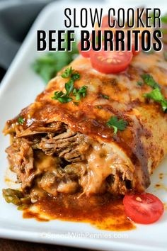 beef recipes Beef burritos couldnt be easier than when made in the slow cooker! This easy recipe uses shredded beef and refried beans wrapped inside a tortilla shell and baked with cheese to create this cheesy authentic dish! Beef Recipes For Dinner, Ground Beef Recipes, Mexican Food Recipes, Slow Cooker Recipes Mexican, Crockpot Beef Recipes, Beef Dinner Ideas, Crockpot Dishes, Mexican Dishes, Sausage Recipes