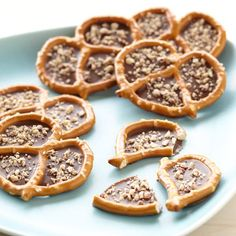 Nutty Candy Filled Pretzels - Regular pretzels will never be the same once you fill them with Wilton Candy Melts candy and add a sprinkle of. Candy Recipes, Cookie Recipes, Dessert Recipes, Dessert Food, Wilton Candy Melts, Biscuits, Brownies, Homemade Candies, How Sweet Eats
