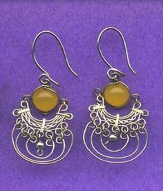 it all starts out as a spool of wire and some beads Hand shaped wire and  bead earrings