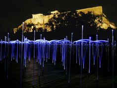 The project inserted a luminous interactive sound and landscape within the plaza to create a constantly choreographed field in flux. Semi-flexible fiber-optic strands responded to the movement of pedestrians through the field, emitting white light and white noise. Activated by the passersby, the fiber optics transmit light from white LEDs while the speakers below the raised deck emit white noise.