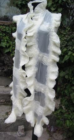 This white bridal nuno felted art shawl is hand felted using certified organic merino wool and transparante shiffon silk. The silk is white, the wool is tender natural white. It can be used as a shawl or as an artistic accessory. Light and soft, elegant and provocative. Measures about 200