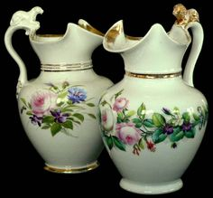 "c1860 Pr porcelain pitchers, lion, lioness, w/lids, Bing & Grondahl, 10""t"