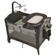 Graco® Pack 'n Play® Playard Portable Napper & Changer™ in soothing green and grey Greenhill fashion. Includes a reversible napper and changer!