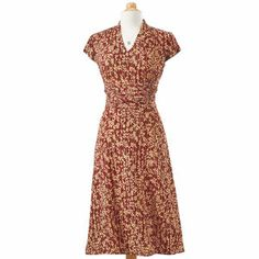 "Sienna shades of the Italian countryside inspire this lovely floral Dress. Romantic in its simplicity, it has a feminine, figure-flattering shape, with a V-neck bodice, gathered-panel waist, and A-line skirt. Cap sleeves and back zipper. 100% sueded polyester. Machine wash. Imported. Misses' 44"" long, Women's 46"" long. Only in NorthStyle! (18W-22W) Add $10"
