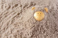 piggy bank in the sand