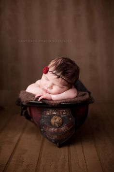 baby girl fire helmet pic..weve been discussing doing a pic like this too!