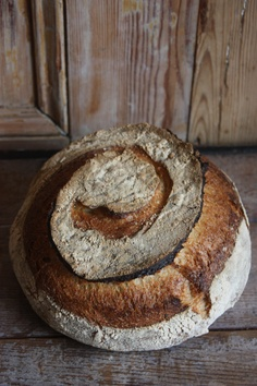 This curly-cue bread has me curious. More wonderful bread shots on Unodedos Recetas' wonderful board of bread styling and recipes.