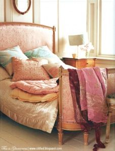"""This bed reminds me of the """"Princess and the Pea"""" with a few matresses missing.  I like the mix of exotic silk fabrics."""