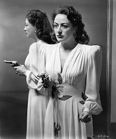 "Joan Crawford in a publicity image for Michael Curtiz's ""Mildred Pierce."" 1945. After her cheating husband leaves her, Mildred Pierce proves she can become independent and successful, but can't win the approval of her spoiled daughter.  Great movie"