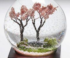 Achieve inner peace during those stressful days with a few shakes of the cherry blossom tree snow globe. The globe depicts a picturesque spring time setting with two exquisite cherry trees that spread their blossoms every time you give the globe a good shake.
