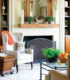 Really like the repetition of orange in this space. Nice living room ideas.