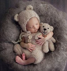 Knitted baby bear suit and matching teddybear toy.