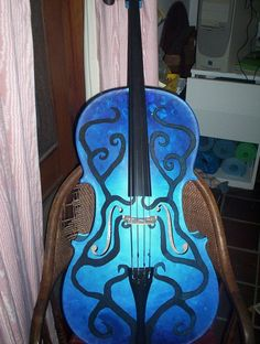 It's a cello. And it's blue.   (Just in case you didn't see it in all of its awesome-ness.)