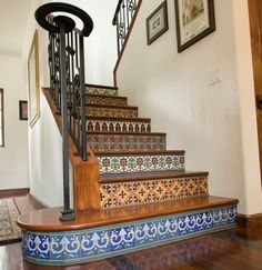 Spanish tile - Hand painted tiles on stair risers. These stair risers are covered with colorful Catalina style tiles, which combine glossy and matte finishes. This adds wonderful depth to the patterns. Tiled Staircase, Tile Stairs, Staircase Design, Mosaic Stairs, Staircase Ideas, Basement Stairs, Stair Design, Stair Railing, Stair Idea