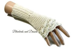 These fingerless gloves have been made in a lovely soft acrylic yarn that has just a subtle sheen to it. Being cream they should go with most Winter coats and jackets and are great if you're buying as a gift and are unsure of what colour would be best, classic cream is always good! The …
