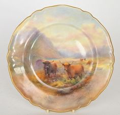 A Royal Worcester cabinet plate decorated by Harry Stinton with highland cattle against a mountainous landscape, puce mark with datecode 1926, diameter 23cm