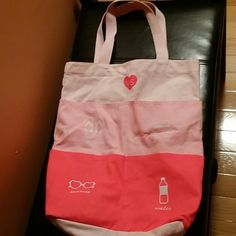 Victoria Secret beach bag Beach bag by Victoria Secret with 6 packets in front and large bag. All shades of pink super comfy and sturdy handles. Super cute heart with logo. Victoria's Secret Bags Totes