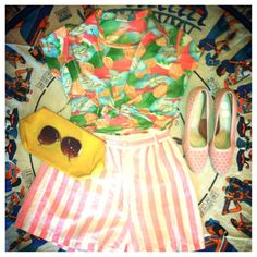 Spring is finally here! '70s patterned top, '80s striped shorts, '50s pink shoes, '80s  yellow purse, retro sunglasses.
