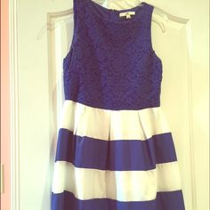Blue and white boutique Dress Boutique brand dress. Worn one time! Royal blue and white silky skirt portion. Royal blue lace top. Knee length. Perfect spring dress! Fits a 8-10 size Ya Los Angeles Dresses Midi