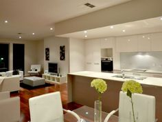 Similar to the layout of the whole open living plan if the kitchen were to be on back wall.