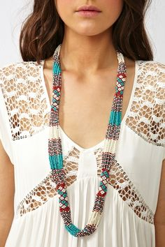 Beautiful beaded necklace -- love how the beaded strands fall inti the tubular peyote beads