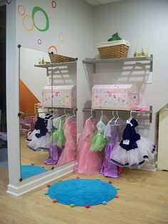 Child's Activity Room, We utiltized part of our basement for a play room for the kids. I wanted it to be colorful and have a place for everything....crafts, dress-up, reading, building, etc. , Dress up nook , Other Spaces Design