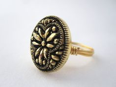 Wire wrapped button ring in black and gold made by LazyOwlBoutique, $21.00